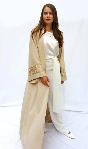 Signature kimono cut abaya in light linen embellished with lace borders on sleeves and back.