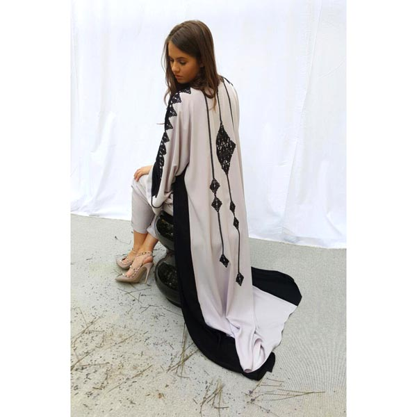 Signature kimono cut abaya with multiple guipure and hand embroidery embellishment on back and sleeves.