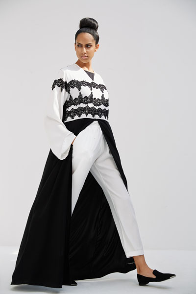 Arabesque classic cut abaya with multiple lines of flower guipure borders on bust.