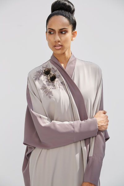 Arabesque signature wrap abaya with asymmetrical flower bouquet , hand embroidery with leather flowers.
