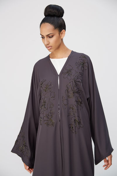 Arabesque kimono cut abaya with flower motif beads embroidery on front and one sleeve only.
