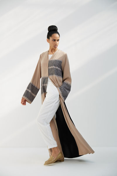 Arabesque classic cut abaya with multiple lines of graphic lace on front body and sleeves.